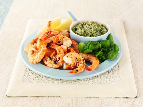 Grilled king prawns with a herb dip