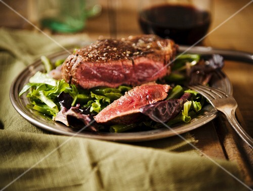 Sliced Grass Fed Sirloin Steak on a Bed of Wine
