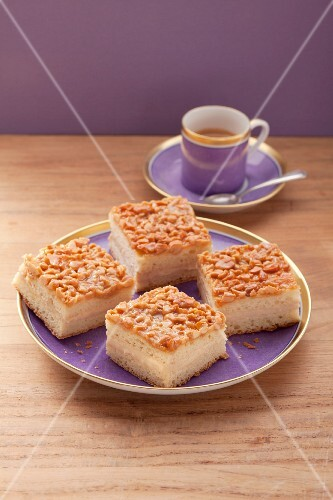 Four pieces of bee sting cake on a purple plate