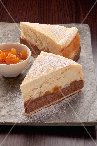 Two slices of cheesecake with apricots
