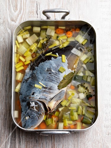 Poached carp with vegetables