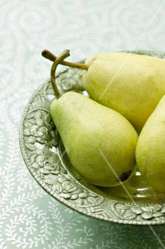 Pears on a green plate