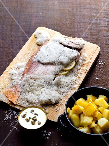 Fish in a salt crust with a side of potatoes