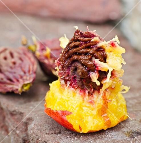 A nectarine stone with fruit flesh