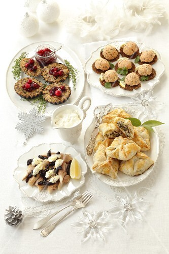 Various Christmas dishes on a laid table
