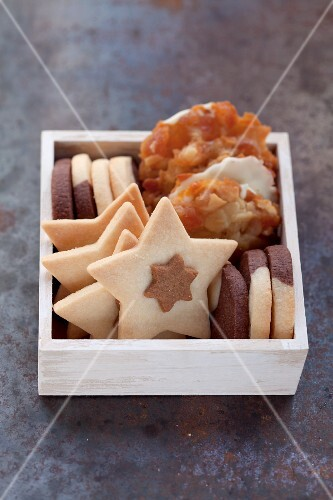 Various biscuits stack upright in a wooden box
