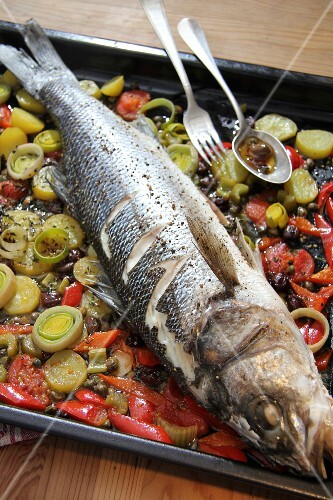 Sea bass on bed of vegetables