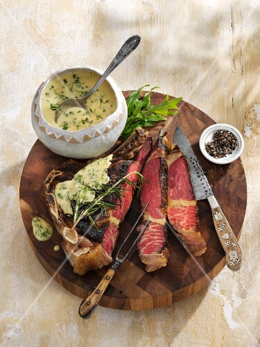 Ribeye steak with a rocket and butter sauce