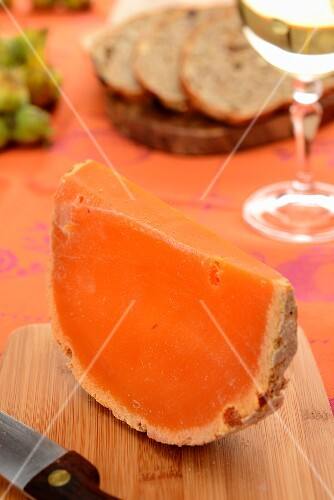 A slice of Mimolette cheese