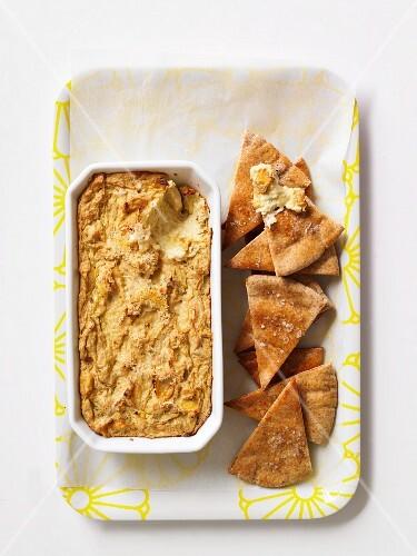 An artichoke dip with unleavened bread