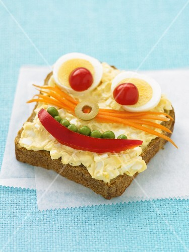 A slice of bread with a funny face