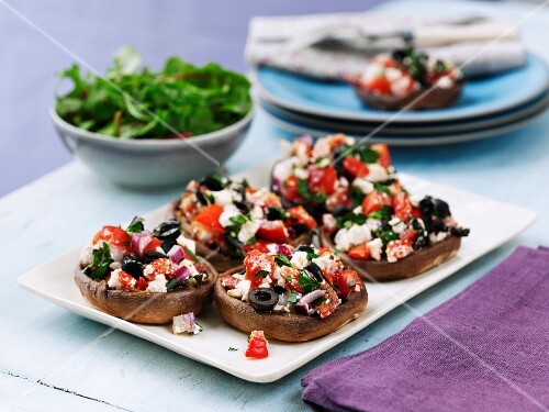 Mushrooms filled with olives, tomatoes and feta