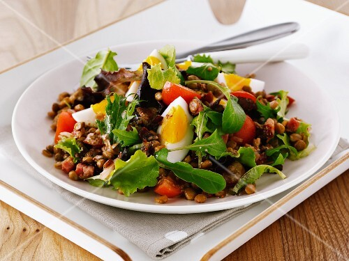 Lentil and chickpea salad with tomatoes and egg
