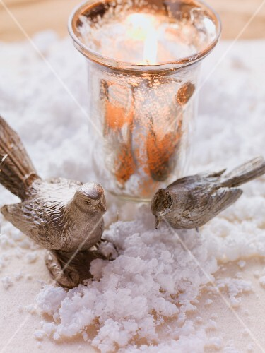 Christmas arrangement with tealight holder and bird ornaments