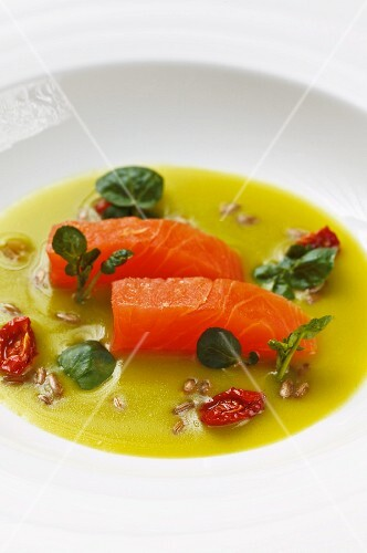 Marinated organic salmon in a stinging nettle broth