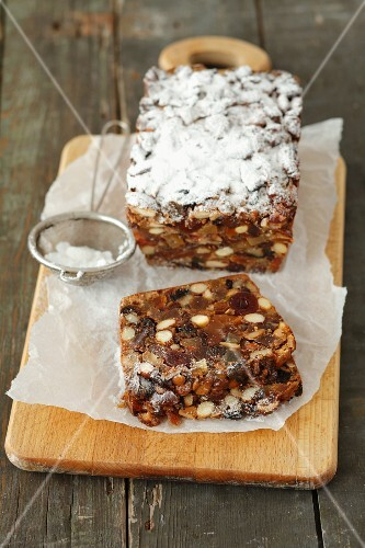 Fruit cake with nuts and icing sugar