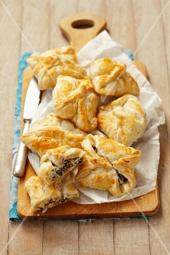 Puff pastry pocket with quark, olives and capers