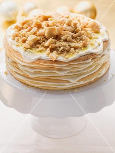 Layered honey cake on a cake stand
