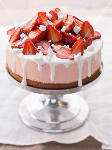Strawberry ice cream cake on a cake stand