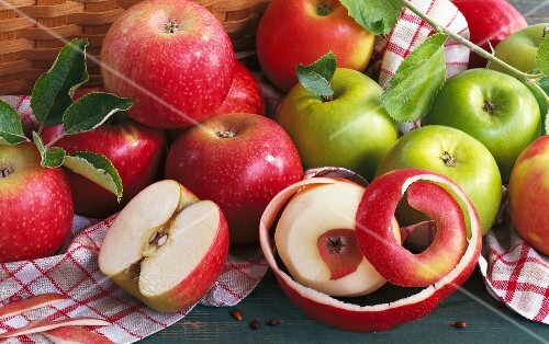 Red and green apples on a tea towel