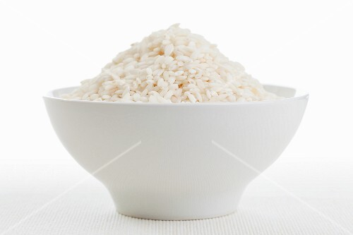 Round grain rice (risotto rice) in a white bowl