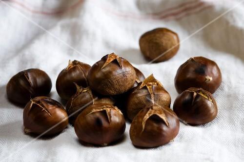Roasted chestnuts on a tea towel