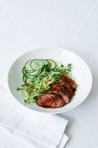 Fried beef and a spicy oriental salad