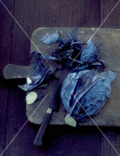 Red cabbage, sliced on a chopping board