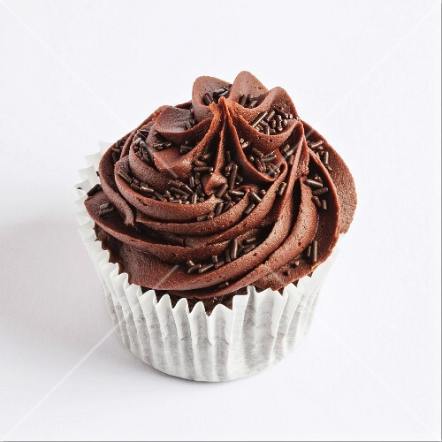 A chocolate cupcake on a white surface