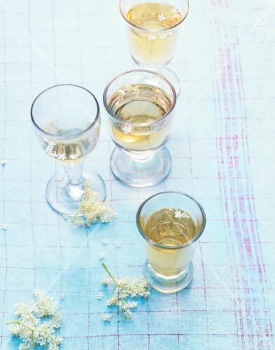 Four glass of elderflower champagne