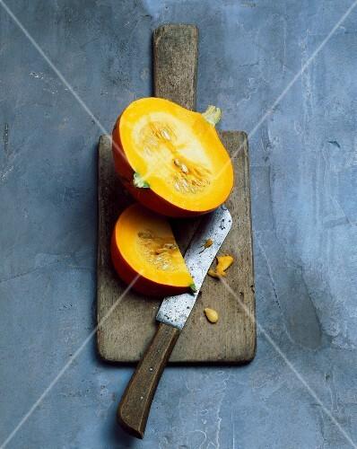 Hokkaido pumpkin, sliced, on a chopping board