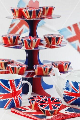 Union Jacks on cupcakes, a cake stand, a teapot and tea cups