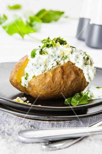 A baked potato with herb quark