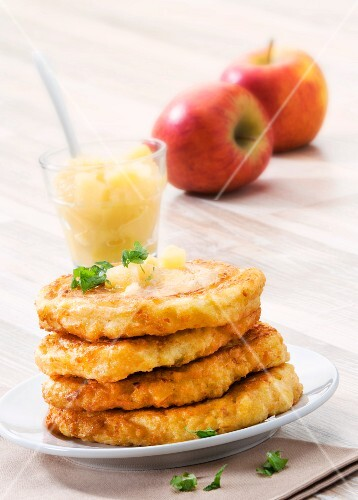 A stack of potato cakes with apple sauce