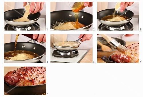 Studded roast ham being glazed with honey