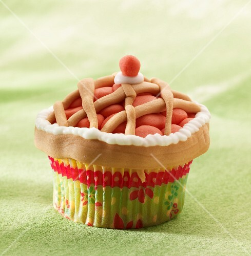 A cupcake decorated to look like a pie
