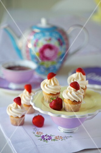 Mini cupcakes decorated with strawberries