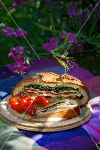Muffalata sandwich with cherry tomatoes
