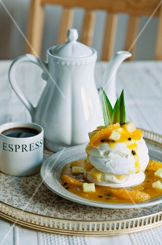 Pavlova with exotic fruits and coffee