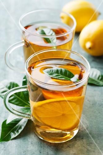 Hot lemon tea with fresh tea leaves