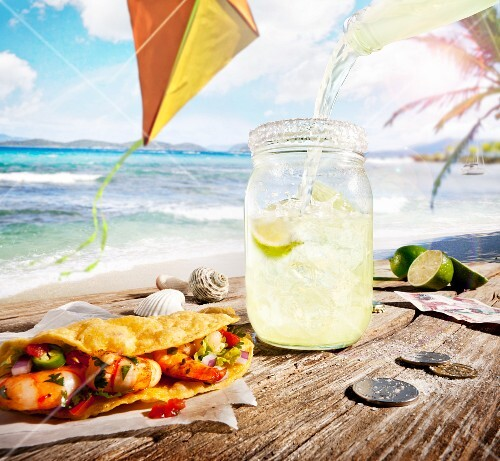Margarita Pouring Over Ice in a Jar; Shrimp Taco; By the Beach with Money on the Table