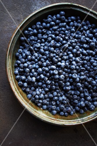 Copper Pan Filled with Fresh Blueberries; From Above
