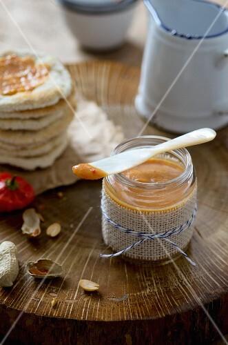 A jar of peanut and chilli sauce