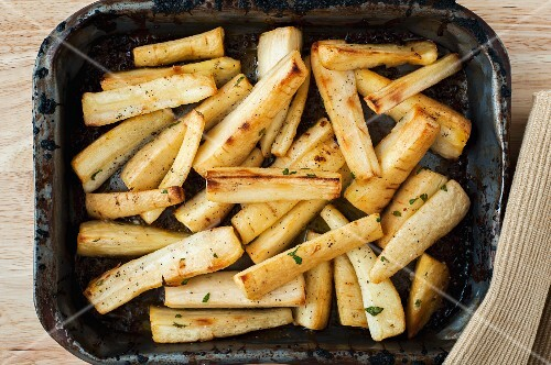 Roast parsnips in an old roasting tin