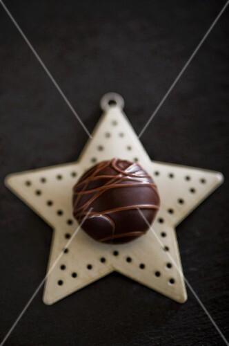 A chocolate praline on a Christmas star