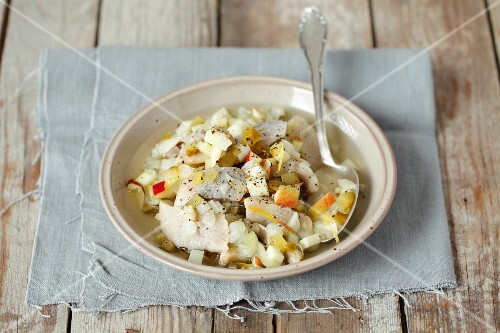 Herring salad with gherkins and apple