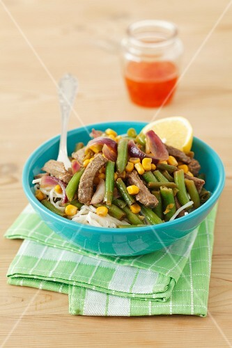 Beef with green beans and sweetcorn on rice noodles