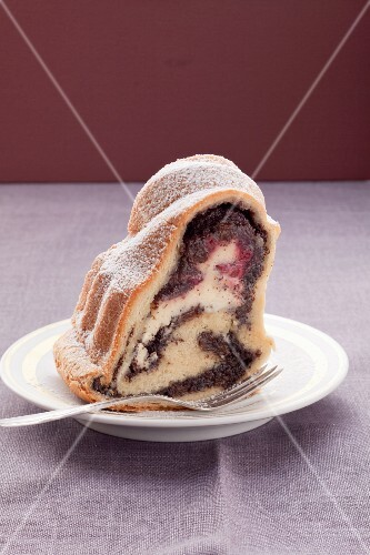 A piece of ring cake with poppy seeds and quark