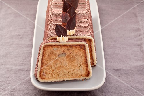 Fruit cake wrapped in decorative striped sponge