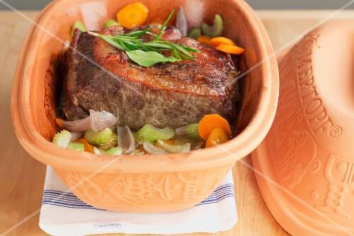 Roast beef in a terracotta pot